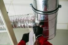 Greiner Heating and Air Conditioning, Man sealing duct work, CA