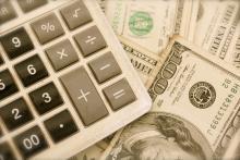100 dollar bills and calculator