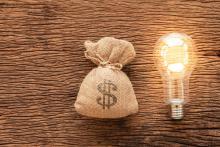 money bag and lightbulb, solar tax credit concept