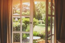 through windows of house, spring time back yard, spring indoor air quality concept