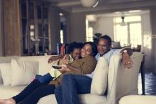 family together on couch comfortable at home
